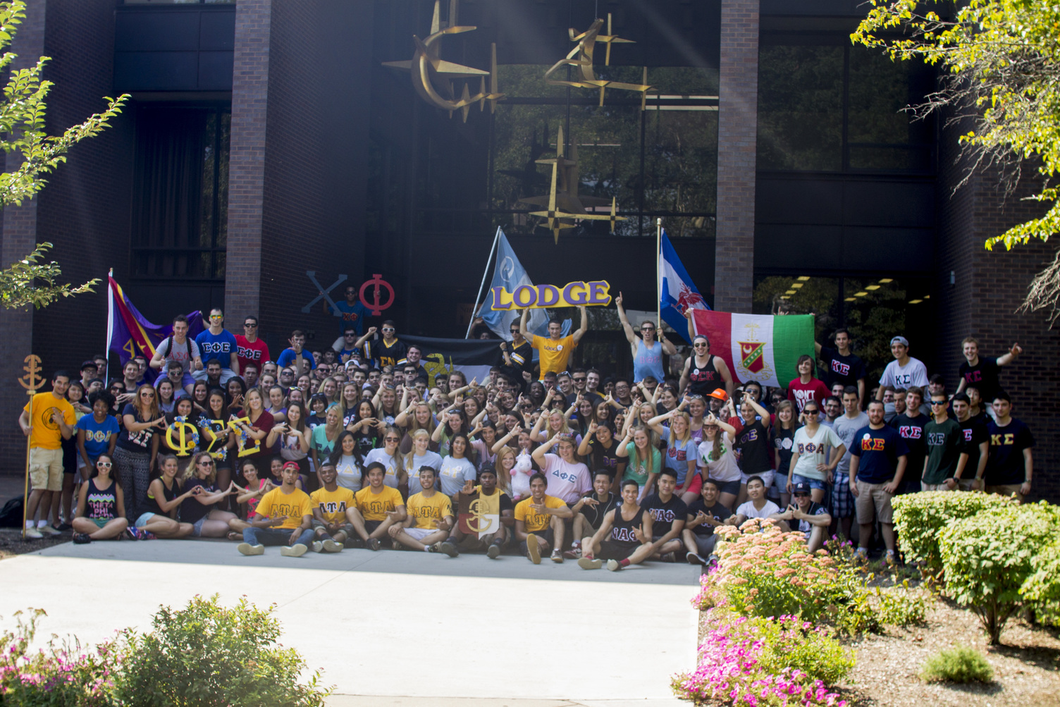 Greek Life students sit in front of Library